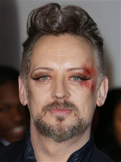 OMG! Boy George shows off thick new curly quiff and crazy