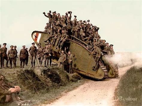WW1 Picture 46 - Canadian troops with a Mark IV tank after